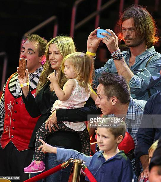 Actress Mira Sorvino and husband Christopher Backus with daughter Mattea Angel Backus attend the premiere of Ringling Bros and Barnum Bailey's...