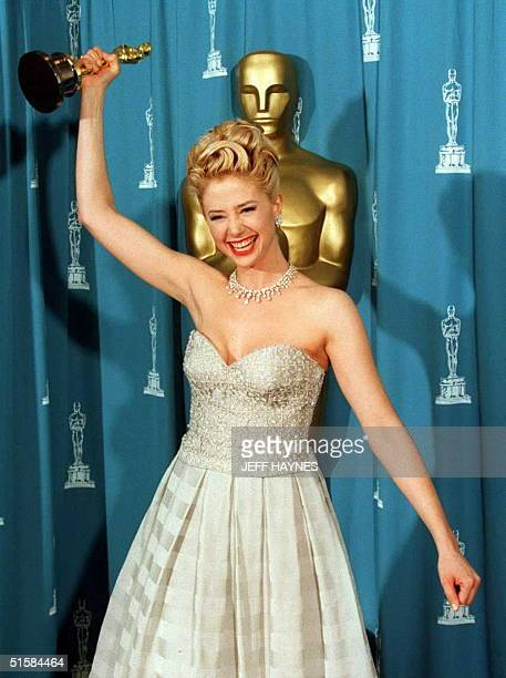 """Actress Mira Sorvino brandishes her Oscar after winning the award for best supporting actress for her role in the film """"Mighty Aphrodite"""" at the 68th..."""