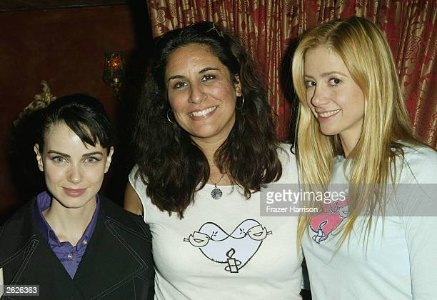 Actress Mira Sorvino with Director of Artist for Amnesty Bonnie Abaunza and Mia Kirshner pose together at Cafe La Boheme where Amnesty International...
