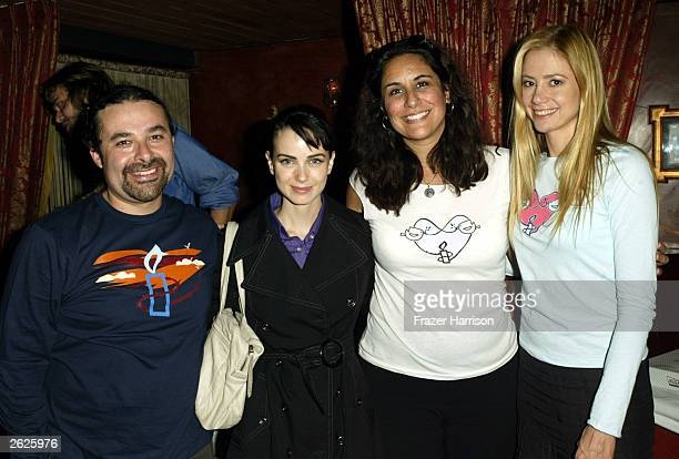 Actress Mira Sorvino with Director of Artist for Amnesty Bonnie Abaunza Actress Mia Kirshner and Mario Tafur of Amnesty International pose together...
