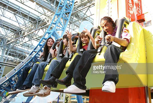 Actress Miranda Cosgrove actor Nat Wolff actor Alex Wolff and recording artist Lil' JJ attend the grand opening of Nickelodeon Universe at the Mall...