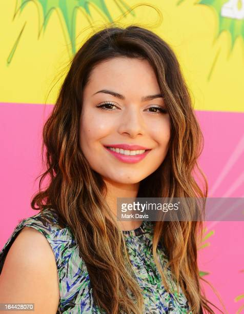 Actress Miranda Cosgrove arrives at Nickelodeon's 26th Annual Kids' Choice Awards at USC Galen Center on March 23 2013 in Los Angeles California