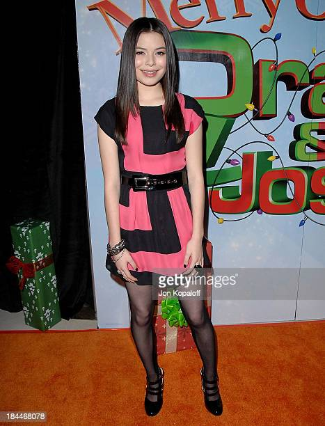 Actress Miranda Cosgrove arrives at the Los Angeles Premiere Merry Christmas Drake Josh at the Landmark Theaters at the Westside Pavillion on...