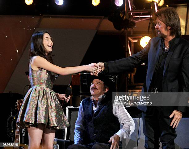 Actress Miranda Cosgrove musicians Kix Brooks and Ronnie Dunn of the band Brooks Dunn onstage during Brooks Dunn's The Last Rodeo Show at MGM Grand...