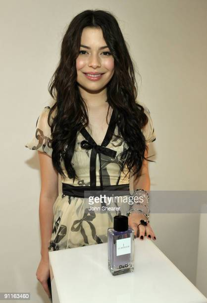 Actress Miranda Cosgrove poses with the DG fragrance bar during the 7th Annual Teen Vogue Young Hollywood Party held at Milk Studios on September 25...