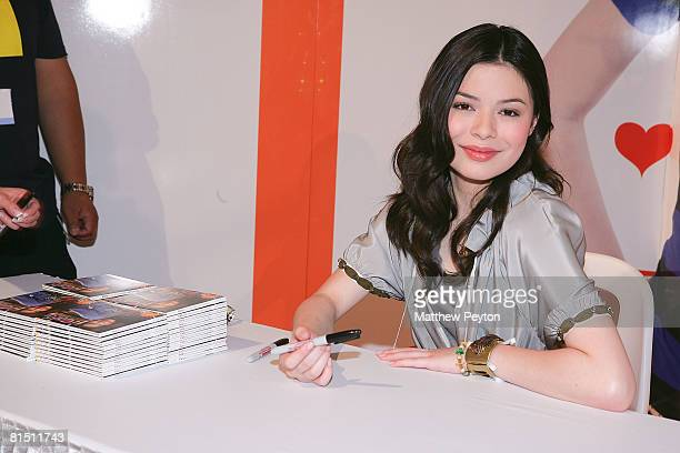 """Actress Miranda Cosgrove signs her new CD """"iPlaylist"""" at the Nickelodeon booth during the 2008 Licencing International Expo at the Jacob Javits..."""