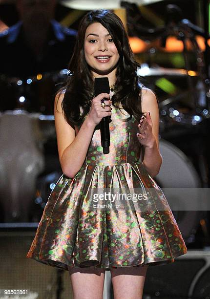 Actress Miranda Cosgrove speaks onstage during Brooks Dunn's The Last Rodeo Show at MGM Grand Garden Arena on April 19 2010 in Las Vegas Nevada