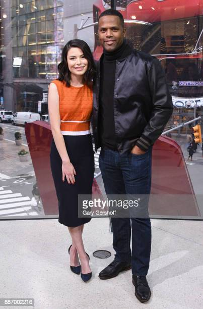 Actress Miranda Cosgrove visits 'Extra' with AJ Calloway at HM Times Square on December 6 2017 in New York City