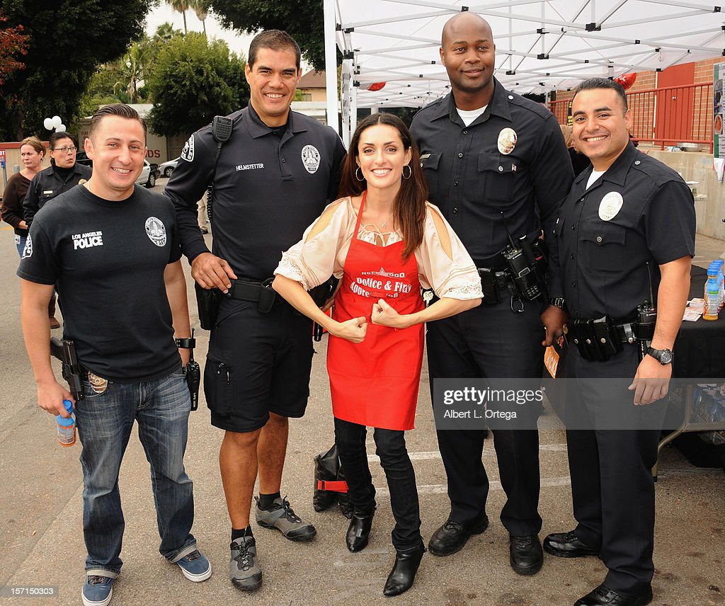 Actress Mirelly Taylor participates in the Hollywood Chamber of Commerce's annual police and firefighters appreciation day at the Hollywood LAPD station on November 28, 2012 in Hollywood, California.