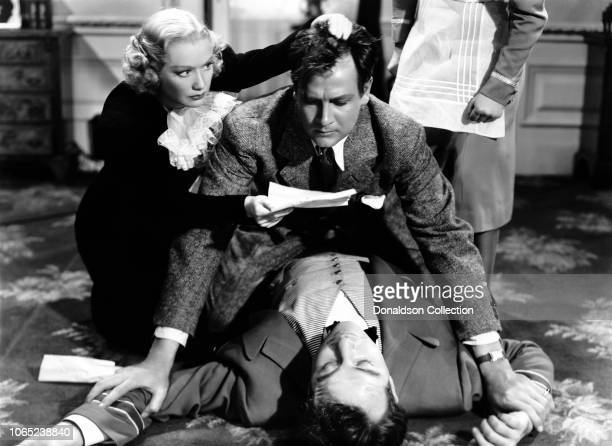 Actress Miriam Hopkins William Hopkins Broderick Crawford in a scene from the movie Woman Chases Man