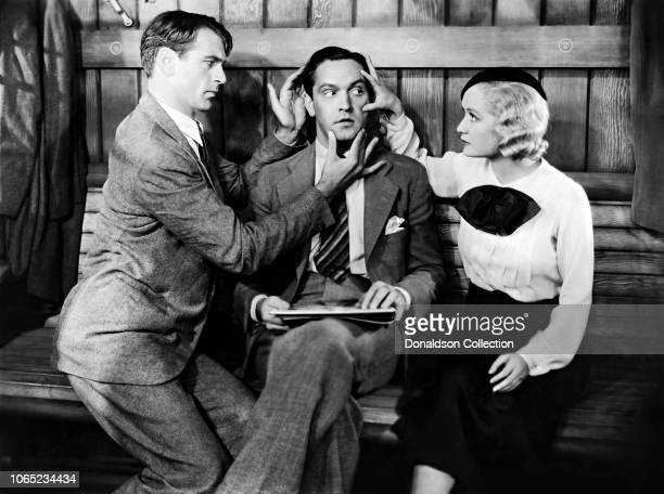 Actress Miriam Hopkins with Fredric March and Gary Cooper in a scene from the movie Design for Living