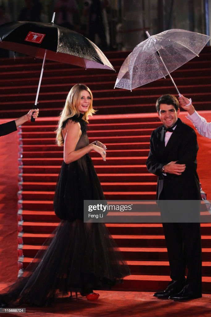 Actress Mischa Barton (L) and Jerome Lambert, CEO of Manufacture Jaeger-LeCoultre arrive at the opening ceremony of the 14th Shanghai International Film Festival on June 11, 2011 in Shanghai, China.