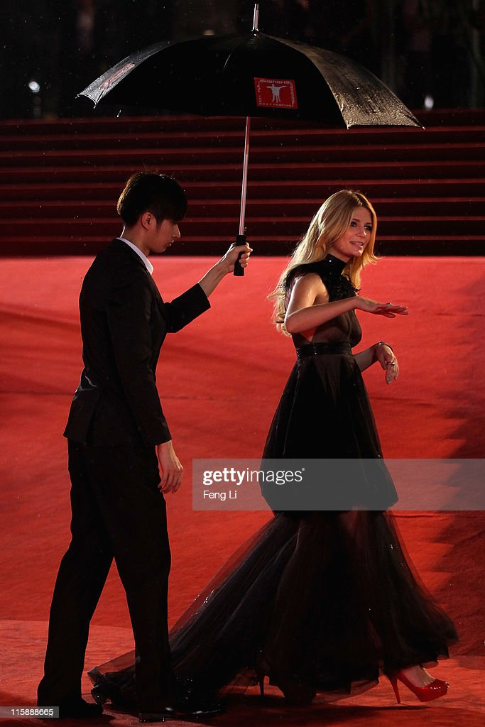 Actress Mischa Barton arrives at the opening ceremony of the 14th Shanghai International Film Festival on June 11, 2011 in Shanghai, China.