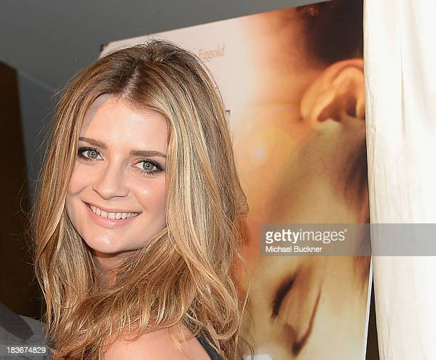 Actress Mischa Barton arrives at the premiere of 'I Will You Into The Dark' at the Landmark Theater on October 8 2013 in Los Angeles California