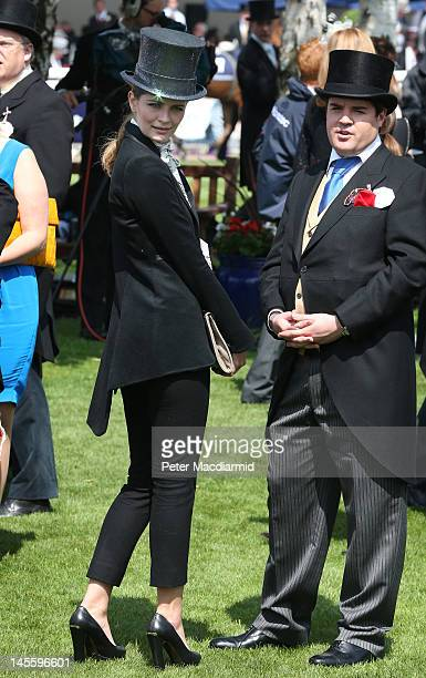 Actress Mischa Barton looks round at the horses in the parade ring before The Derby on June 2, 2012 in Epsom, England. For only the second time in...
