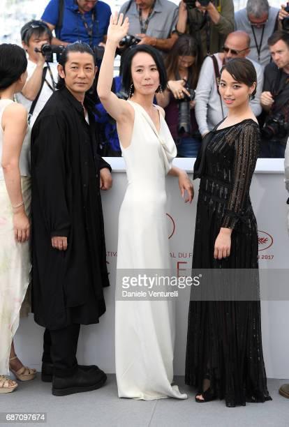 Actress Misuzu Kanno actors Nagase Masatoshi Director Naomi Kawase and Ayame Misaki attend the 'Hikari ' photocall during the 70th annual Cannes Film...