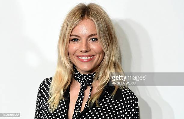 Actress model and designer Sienna Miller attends the Michael Kors Spring 2017 Runway Show during New York Fashion Week in New York on September 14...