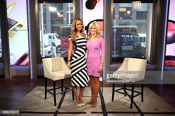 Actress model and Miss USA 2015 Olivia Jordan poses for a photo with FOX Friends host Ainsley Earhardt when she visits 'FOX Friends' at FOX Studios...