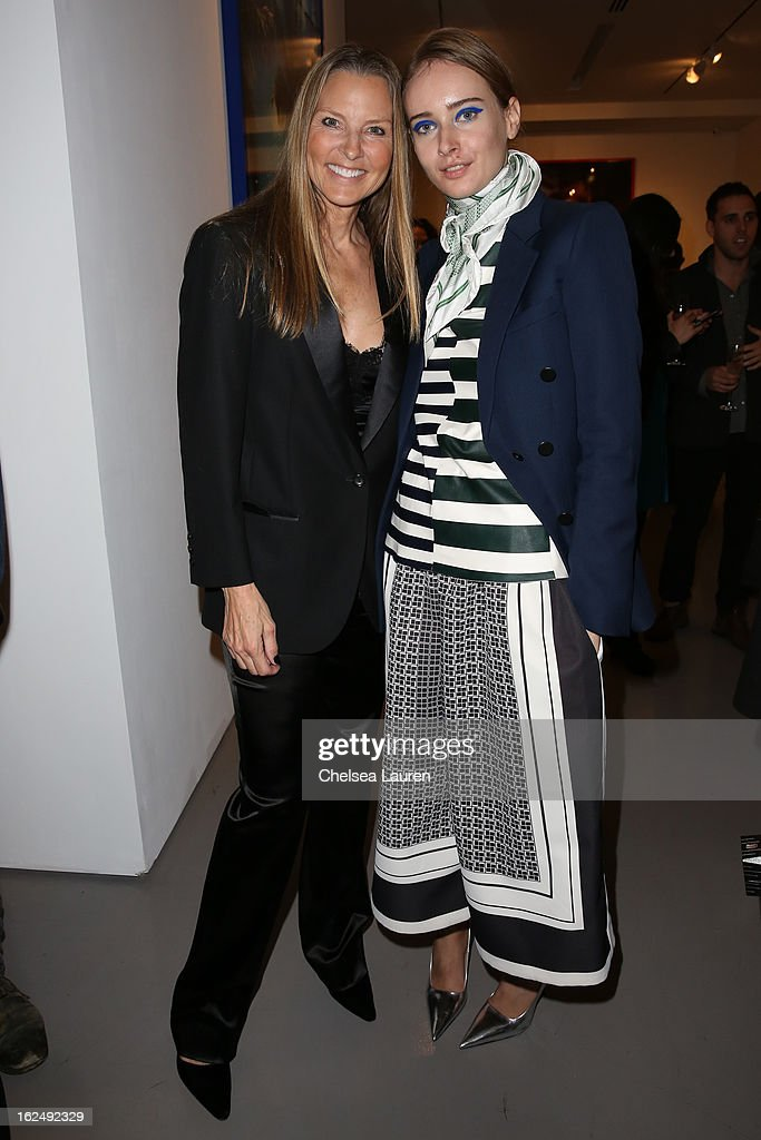 Actress / model Bo Derek (L) and Olga Sorokina visit the Mario Testino opening at PRISM during Academy Awards week on February 23, 2013 in Los Angeles, California.