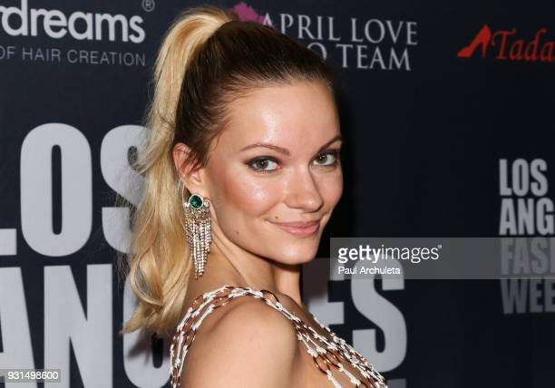 Actress / Model Caitlin O'Connor attends the Domingo Zapata Fashion Show at the Los Angeles Fashion Week 10th season anniversary at The MacArthur on...