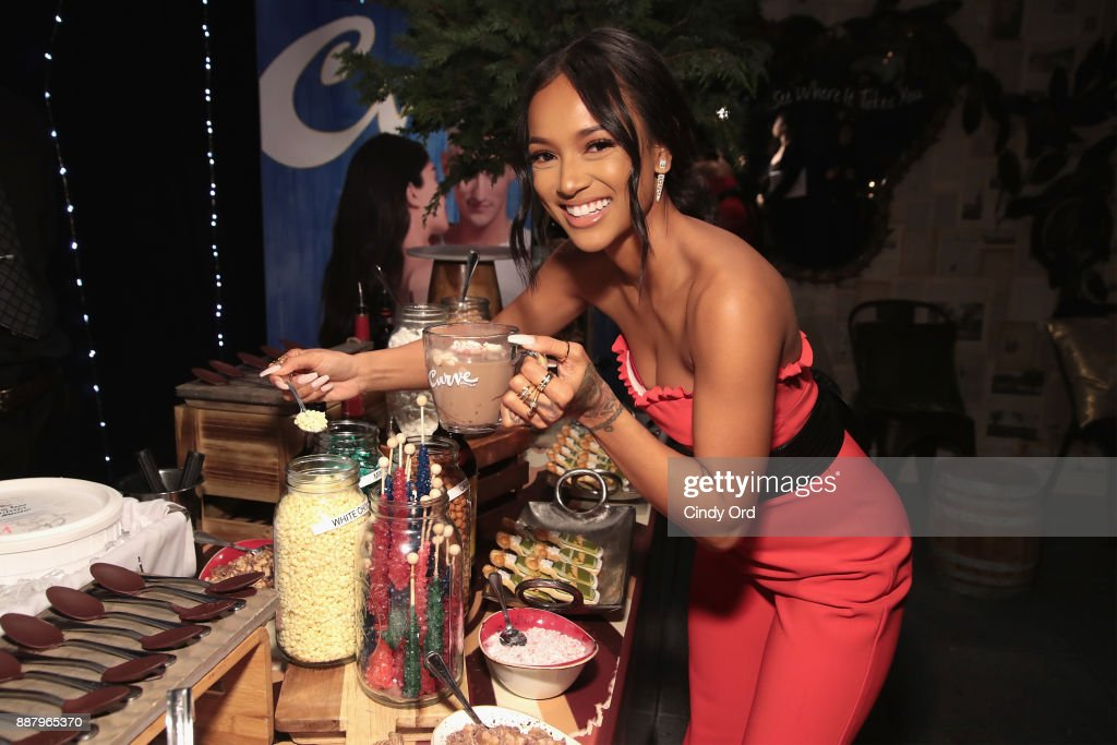 Actress & Model Karrueche Tran visits the hot chocolate bar as she hosts the Curve Fragrances Holiday Party at Arlo NoMad on December 7, 2017 in New York City.