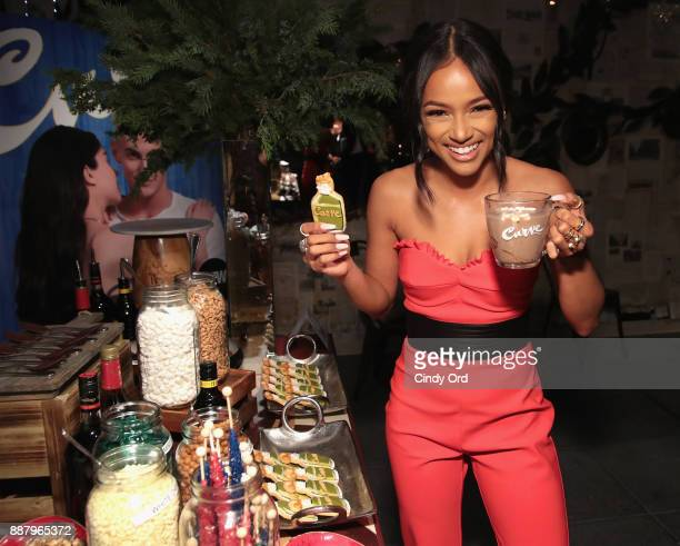 Actress Model Karrueche Tran visits the hot chocolate bar as she hosts the Curve Fragrances Holiday Party at Arlo NoMad on December 7 2017 in New...
