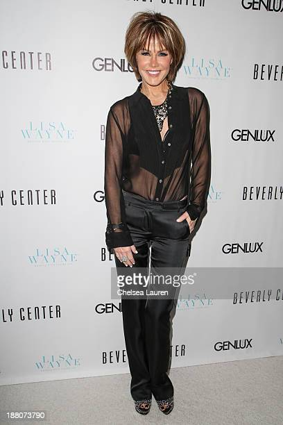 Actress / model Laura Dunn arrives at the Genlux new issue launch party hosted by Lisa Vanderpump on November 14 2013 in Beverly Hills California