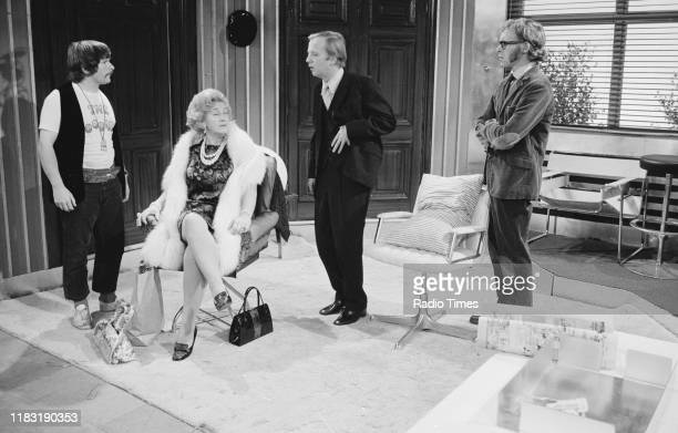 Actress Mollie Sugden and comedians Bill Oddie Tim BrookeTaylor and Graeme Garden in a sketch from episode 'Caught in the Act' of the BBC television...