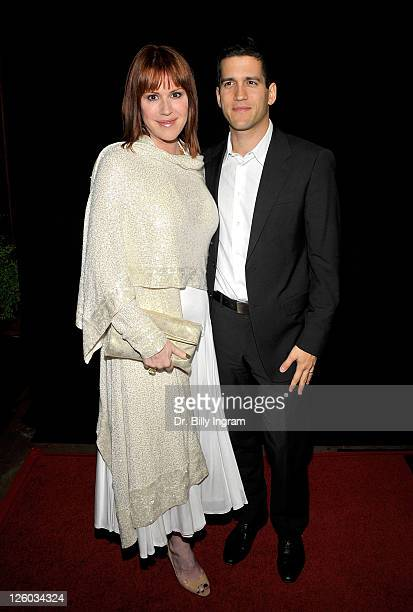 Actress Molly Ringwald and her husband Panio Gianopoulos arrive at the 36th Annual Los Angeles Film Critics Association Awards at InterContinental...