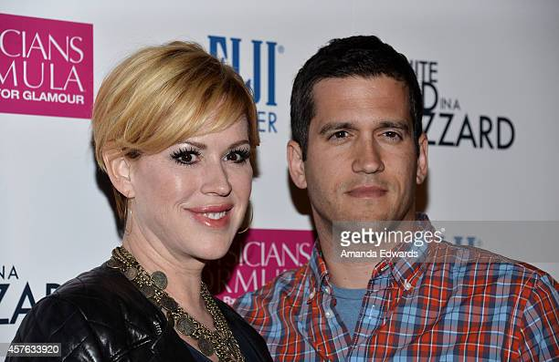 Actress Molly Ringwald and her husband Panio Gianopoulos arrive at the Los Angeles premiere of White Bird In A Blizzard at ArcLight Hollywood on...