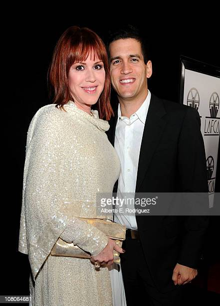 Actress Molly Ringwald and husband Panio Gianopoulos arrive at the 36th Annual Los Angeles Film Critics Association Awards at the InterContinental...