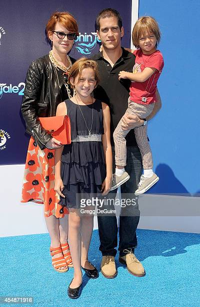 Actress Molly Ringwald and husband Panio Gianopoulos arrive at the Los Angeles premiere of Dolphin Tale 2 at Regency Village Theatre on September 7...