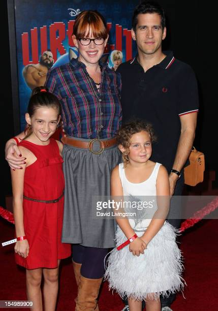 Actress Molly Ringwald and husband Panio Gianopoulos pose with their children at the premiere of Walt Disney Animation Studios' WreckIt Ralph at the...
