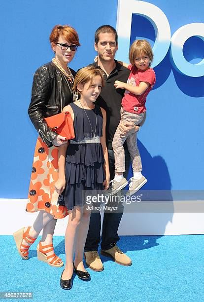 Actress Molly Ringwald husband Panio Gianopoulos and children arrive at the Los Angeles premiere of 'Dolphin Tale 2' at Regency Village Theatre on...
