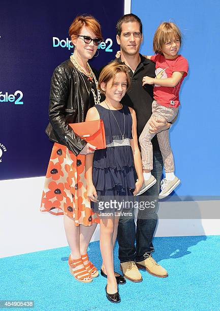 Actress Molly Ringwald husband Panio Gianopoulos and children attend the premiere of Dolphin Tale 2 at Regency Village Theatre on September 7 2014 in...