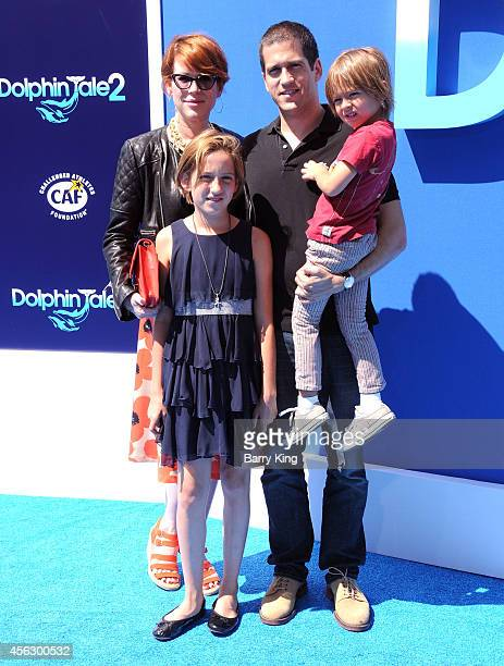Actress Molly Ringwald husband Panio Gianopoulos and their kids Mathilda and Roman attend the premiere of 'Dolphin Tale 2' at Regency Village Theatre...