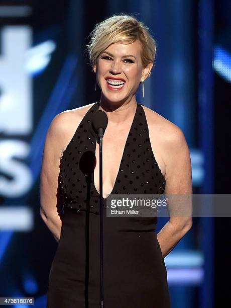 Actress Molly Ringwald introduces a performance by Simple Minds onstage during the 2015 Billboard Music Awards at MGM Grand Garden Arena on May 17...