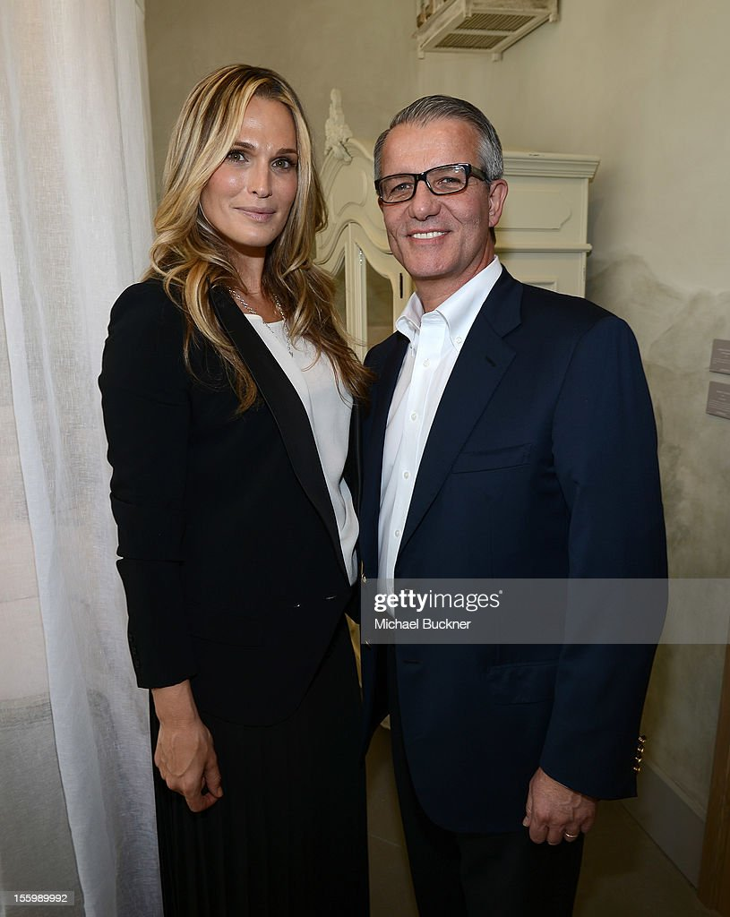 Actress Molly Sims (L) and Carlos Alberini, CEO of Restoration Hardware, attend the Restoration Hardware Baby And Child Gallery Opening at Third Street Promenade on November 10, 2012 in Santa Monica, California.