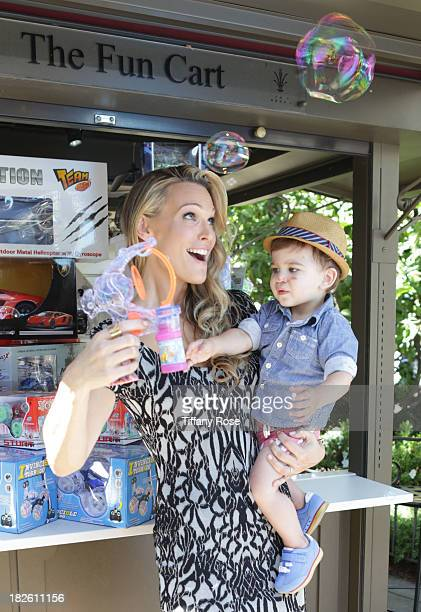 Actress Molly Sims and son Brooks plays with bubbles at the Airbnb Hello LA Event at The Grove on September 30 2013 in Los Angeles California