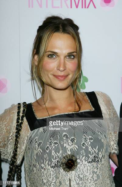 Actress Molly Sims arrives at the Intermix Boutique store opening at the Intermix Boutique store on September 25 2007 in West Hollywood California