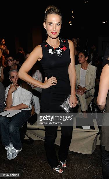 Actress Molly Sims attends the Donna Karan New York Spring 2012 fashion show during MercedesBenz Fashion Week at 547 West 26th Street on September 12...