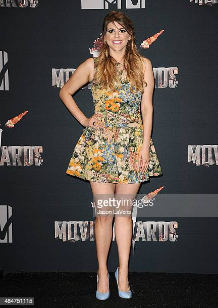 Actress Molly Tarlov poses in the press room at the 2014 MTV Movie Awards at Nokia Theatre LA Live on April 13 2014 in Los Angeles California