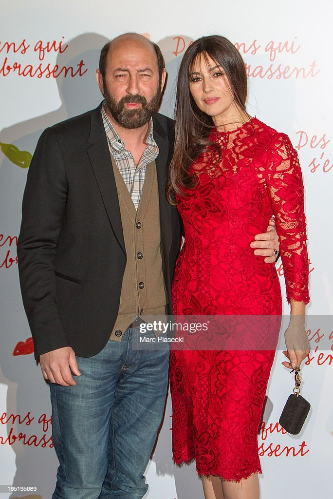 Actress Monica Bellucci and actor Kad Merad attend the 'Des Gens Qui S'embrassent' Premiere at Cinema Gaumont Marignan on April 1, 2013 in Paris, France.