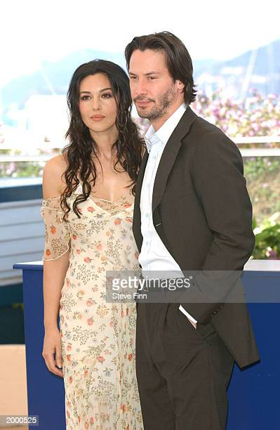 Actress Monica Bellucci and actor Keanu Reeves pose at a photocall for the film The Matrix Reloaded at the Palais des Festivals during the 56th...