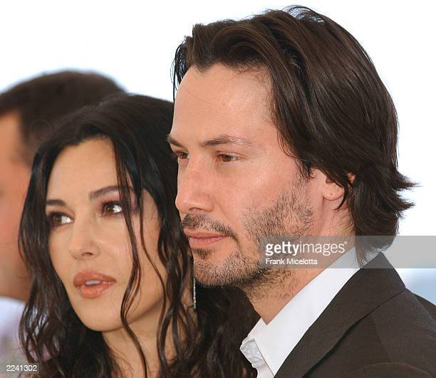 Actress Monica Bellucci and actor Keanu Reeves pose at a photocall for the film The Matrix Reloaded at the 56th International Cannes Film Festival...