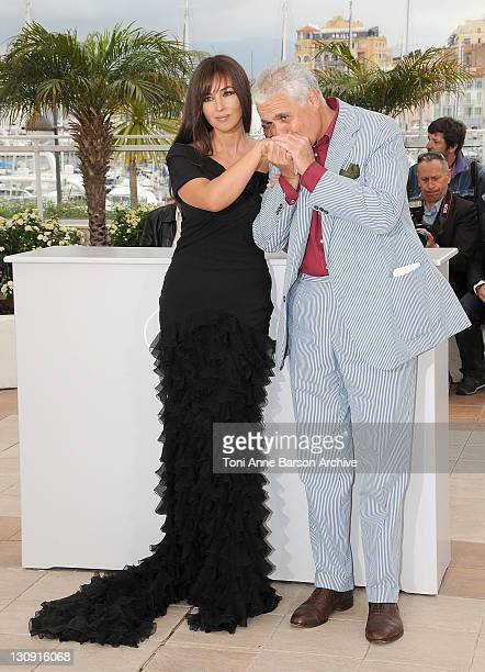 Actress Monica Bellucci and director Marco Tullio Giordana attends the Une Historie Italienne photocall at the Palais des Festivals during the 61st...