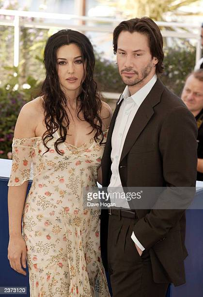 Actress Monica Bellucci and Keanu Reeves attend the premiere of The Matrix Reloaded at the 56th International Film Festival on May 15 2003 in Cannes