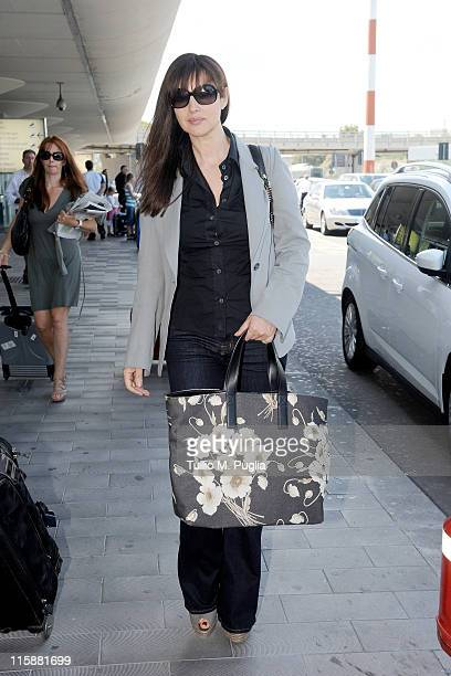 Actress Monica Bellucci arrives at the Catania airport to attend the 57th Taormina Film Fest on June 11 2011 in Catania Italy