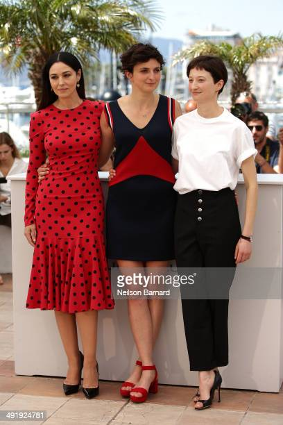 Actress Monica Bellucci director Alice Rohrwacher and actress Alba Rohrwacher attend the 'La Meraviglie' photocall during the 67th Annual Cannes Film...