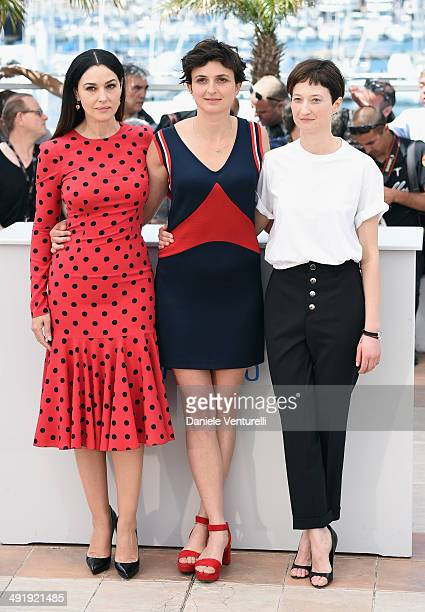 Actress Monica Bellucci director Alice Rohrwacher and Alba Rohrwacher attends 'The Wonders' photocall at the 67th Annual Cannes Film Festival on May...